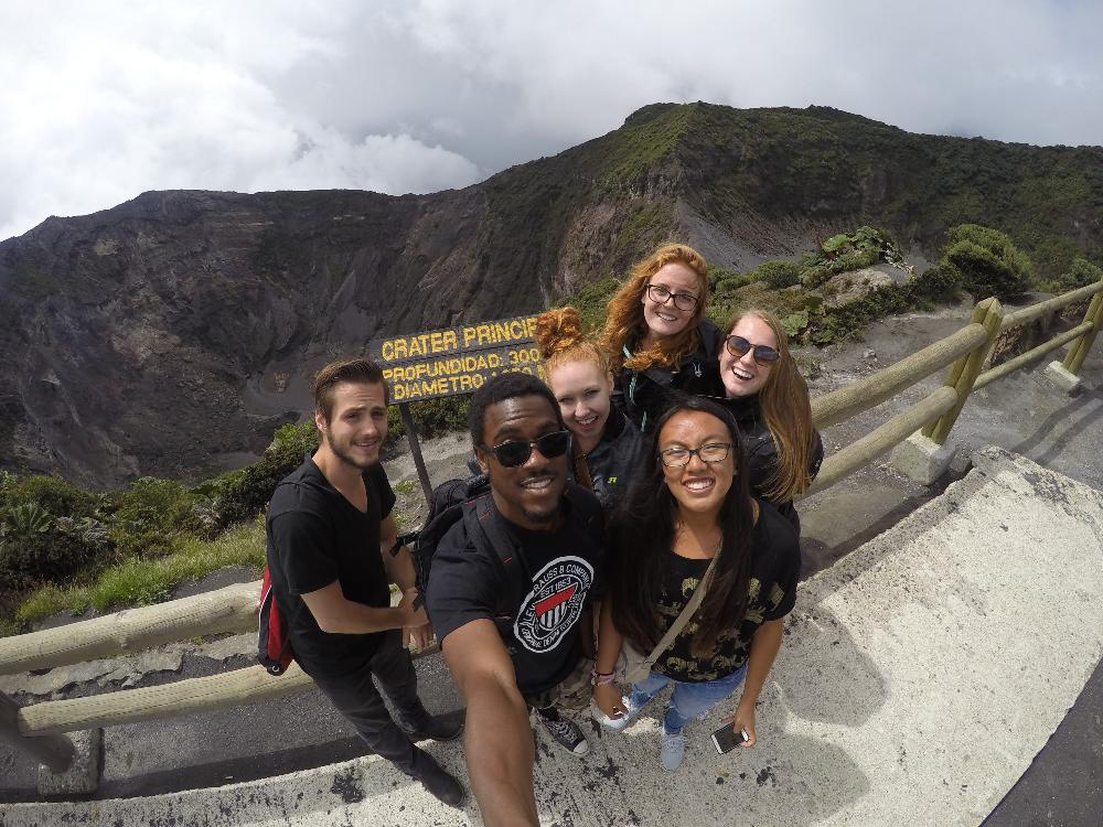 Students taking a selfie on top of a mountain