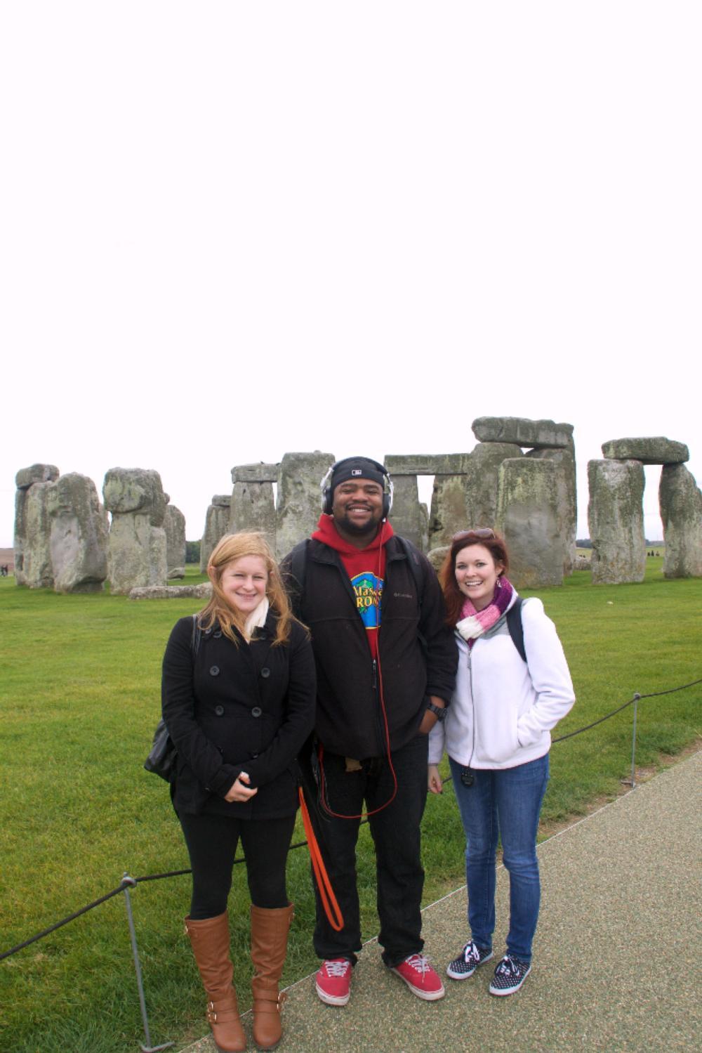 Students posing outside of Stonehenge
